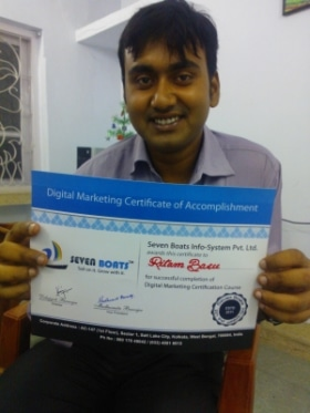 happy student with digital marketing certificate from Seven Boats