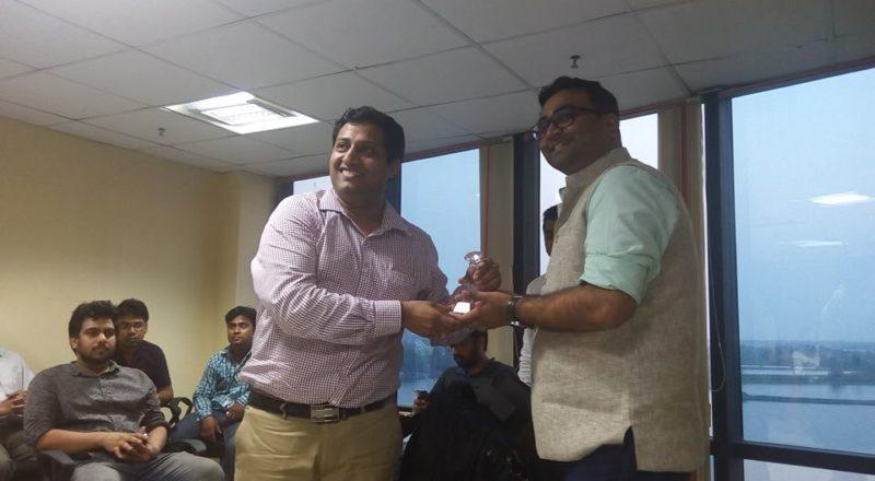 Mr. Vikas Malpani is receiving a memento from Mr. Abhishek Rungta